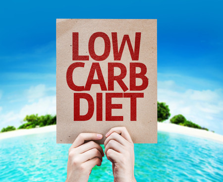53861827 - cardboard low carb diet text on island background