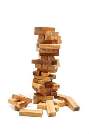 15158933 - instability building blocks at risk concept,on white background
