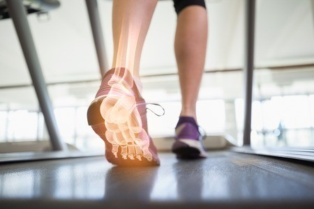 44790049 - digital composite of highlighted foot bones of jogging woman